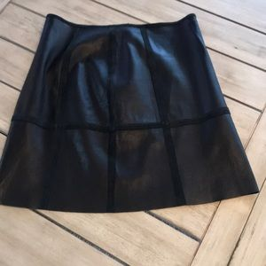 Leather mini skirt with suede piping details